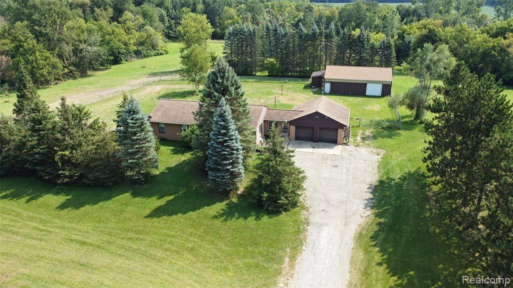 Have a love for the outdoors? This home is a true outdoor/hunters dream! Sitting on just under 15 acres of beautiful land this home is just what you have been looking for. Plenty of storage with the 30x40 pole barn and attached 2 car garage. The home has quite a few updates including bathrooms, electrical, doors and more. Relax this fall outside on the back deck and stay cozy this winter with the two natural fire places. Davison school district.