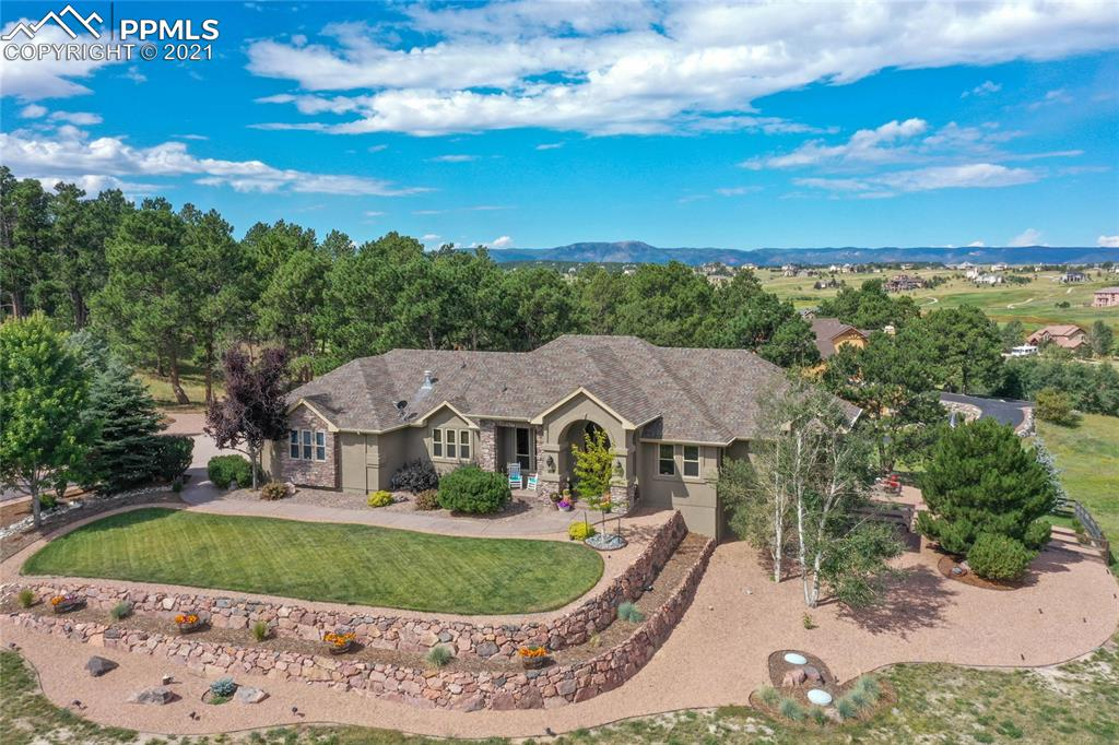Luxury in every detail. Custom-built ranch-style home located on a 2.5-acre private lot in the Kings Deer Neighborhood. No traffic to hear or see at the end of this short cul-de-sac.  Beautifully landscaped with large pine trees.  The open floorplan of the large kitchen/living area is made even more appealing with a raised, beamed ceiling and a wall of windows.  The expansive upper-level deck is partially covered, and the grill with a gas line hookup remains with the house.  The upgraded Bosch kitchen appliances are only one of the many special features of this dream kitchen. A Viking six-burner gas range and an extra-long granite bar/counter are also a luxury of this gourmet culinary space.  The master retreat is very large with a spa-like five-piece bath; a glass block shower and a gas fireplace.  There are his and hers separate walk-in closets.  The main level also has an office, a large laundry/craft area (with new barn door entry), and a very big walk-in pantry.  The four-car garage is oversized with great storage areas and conveniently located directly off the kitchen.  The lower level is accessed by a wide, wood stairway. The family room with a wet bar walks out to a dramatic outdoor space of stamped concrete and a fire pit  The rear yard is securely fenced for even small dogs.  There is a second en suite on the lower level and two additional bedrooms with a Jack-and-Jill bath.  The mechanical/storage area is extremely large and houses two furnaces.  The home also has central air and a Radon mitigation system.