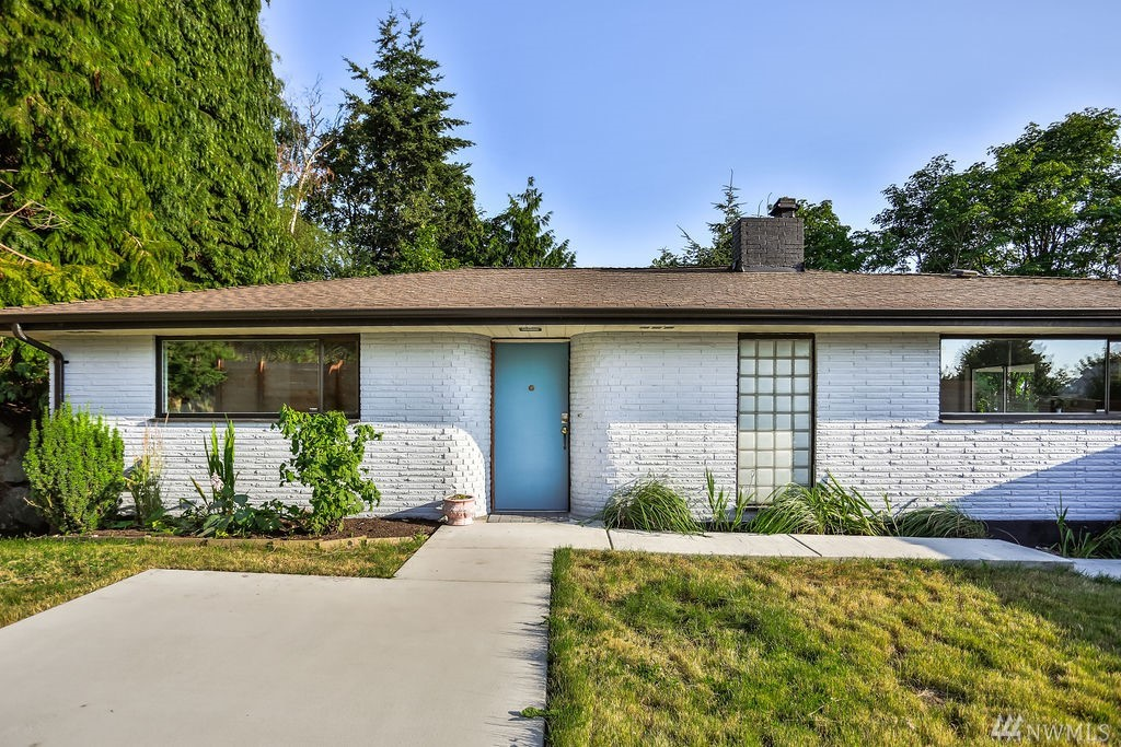 Attention Mid Century Lovers! You will want to see this home. 1950s charm w/ wonderful updates. Large MIL Unit has separate entrance, parking, laundry & yard. Live upstairs (2 bed/1 bath) & rent downstairs (2 bed/2 bth)-or just use the whole house as your own. Custom features: built-in closets, writing desk, white stone fireplace & 50's lighting. Newer roof. 5+ parking spaces plus 1 car garage. Access all freeways, near Renton Landing & ample shopping. Landscaped w/ fruit trees & garden space.