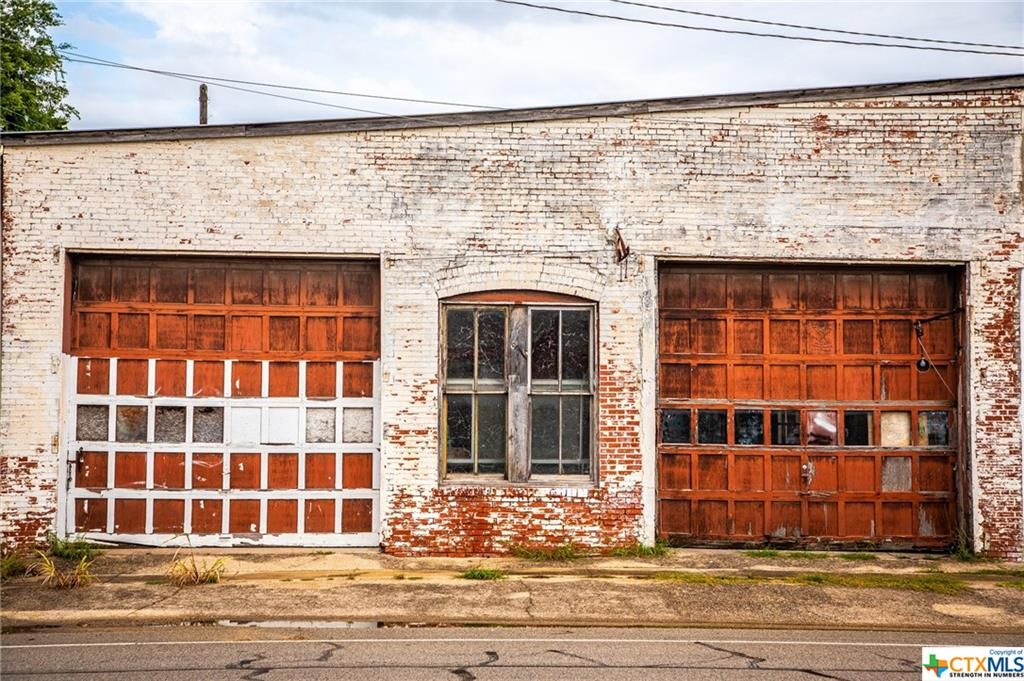 LOCATION LOCATION! Let your imagination run wild! Opportunities are endless! So much room for activities! This is a shell of a building in Historic Downtown Bartlett.  It is being sold 'as is where is'.  Currently the building has a partial roof and has been left vacant for many years.  It is filled with potential and is ready for the right owner to take advantage of all that Bartlett has to offer as it grows and re-develops.  Please note that this is technically two buildings and can be subdivided into two or used as one large building.  Perfect for a pizza joint, beer garden, retail shop, anything you can imagine!
