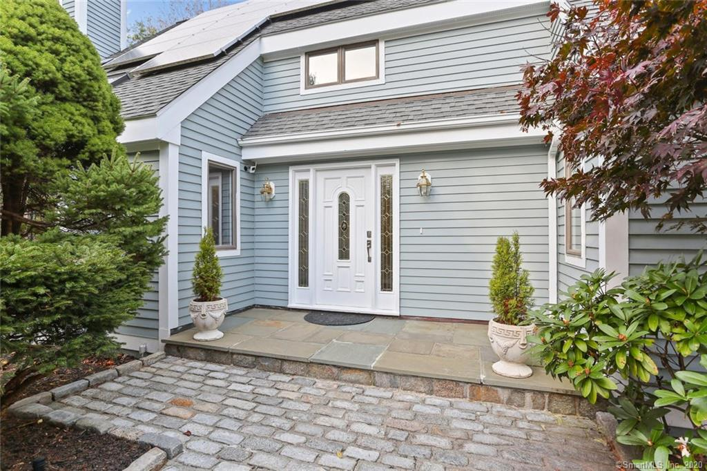 Gorgeous, fully updated home set behind sweeping, level lawns amid landscaped gardens. Backed by nature preserve, this home offers tranquility and privacy, adjacent to Westport border. One-level living option with master suite on main level. Sun-filled rooms enhanced with skylights. All baths newly renovated. Family room has soaring cathedral ceiling, magnificent fieldstone fireplace. Array of recent updates include new recessed LED lighting, contemporary light fixtures, new stainless kitchen appliances and quartz countertop. New or refinished oak floors, new carpeting. Tech updates include solar system for low cost electric; dehumidifier/water guard to ensure dry basement; Generac generator. Well-designed, custom-built and eco-friendly home, superior quality throughout. Spacious bedrooms upstairs including possible master. Exterior and interior all freshly painted in stylish neutrals. Park-like setting with 2+ level acres, hard to find this quality of land in Greenfield Hill! Saltwater filtered swimming pool enclosed with wrought-iron fence. Property backs up to Brett Woods nature preserve, 85 unspoiled acres ideal for hiking. Convenient location moments from Merritt Pkwy, quick access to Westport or Fairfield shopping. A turnkey home, impeccably cared for, surrounded by beautiful landscaping.