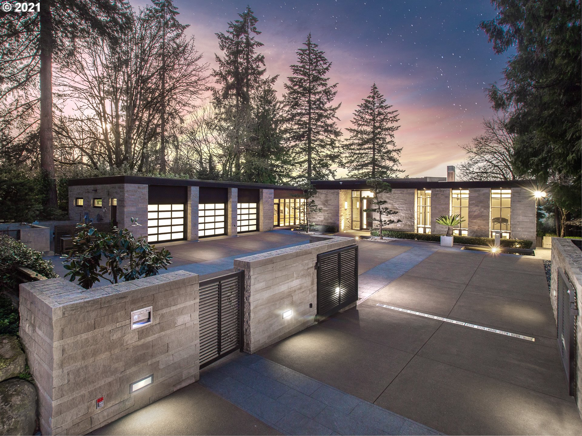 A paradise of contemporary custom architecture, sparkling lake views, private dock & incredible infrastructure, this retreat sanctuary features walls of glass, heated limestone floors, fine marble/millwork & superb Zen-inspired lines. Main lvl living w/magnificent  owner's suite, wine cellar, fitness studio, library, multi-level decks & greenhouse at your fingertips. Sauna/steam room, spectacularly appointed gourmet kitchen & over 1600 ft of bonus/storage. Truly elevated lakefront living!