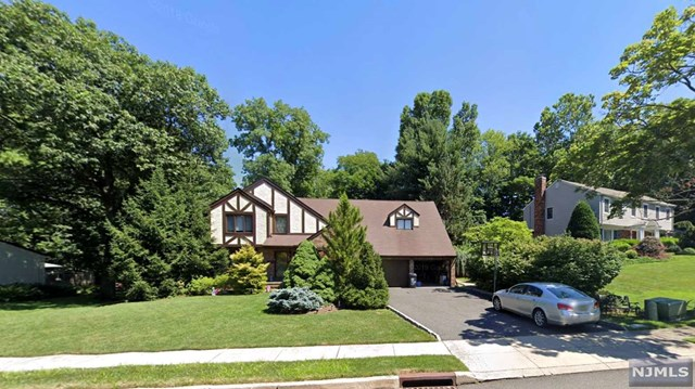 BEAUTIFUL EAST-HILL LOCATION ON A CUL-DE-SAC, THIS 8 ROOM COLONIAL OFFERS ALL LARGE ROOMS WITH HARDWOOD FLOORS ON BOTH 1ST AND 2ND FLOORS, EXCELLENT SIZE IN ALL ROOMS AND A HUGE DECK OFF THE EATING AREA IN THE KITCHEN. A BEAUTIFUL FIREPLACE IN THE FAMILY W/ A 2ND EXIT TO THE DECK W/ A LARGE WHIRLPOOL TUB. LARGE FORMAL LIV/RM, AND A FORMAL DIN/RM W/ CATHEDRAL CEILING AND A LG PICTURE WINDOW. A TOTALLY FINISHED BASEMENT WITH EXERCISE ROOM AND FULL BATH WET BAR AND SUMMER KITCHEN MAKE FOR ALL THE COMFORTS ON A PROFESSIONALLY LANDSCAPED PROPERTY.