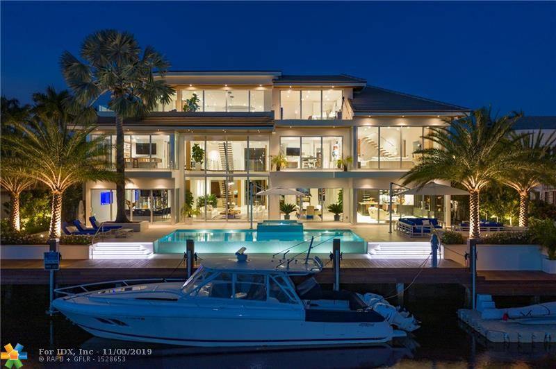 Custom ultra-modern 3 story masterpiece w/100' of WF on a wide canal. Just minutes to the inlet w/ Intracoastal views from 2nd & 3rd levels! Gourmet kitchen with top-of-the-line appliances. High-end finishes & features throughout - Ralph Lauren fixtures, custom woodwork, wine room, whole house generator, gym, elevator, theater, smart home security & automation systems. 3rd-floor entertainment space w/ wet bar & breathtaking views of the Intracoastal & downtown Fort Lauderdale. Immense master suite w/ sitting area, fireplace, water views & over-sized luxurious master bathroom. Private Harbor Beach Surf Club with 300 ft of beachfront & private marina membership available. PLEASE VISIT: 14IslaBahia.com