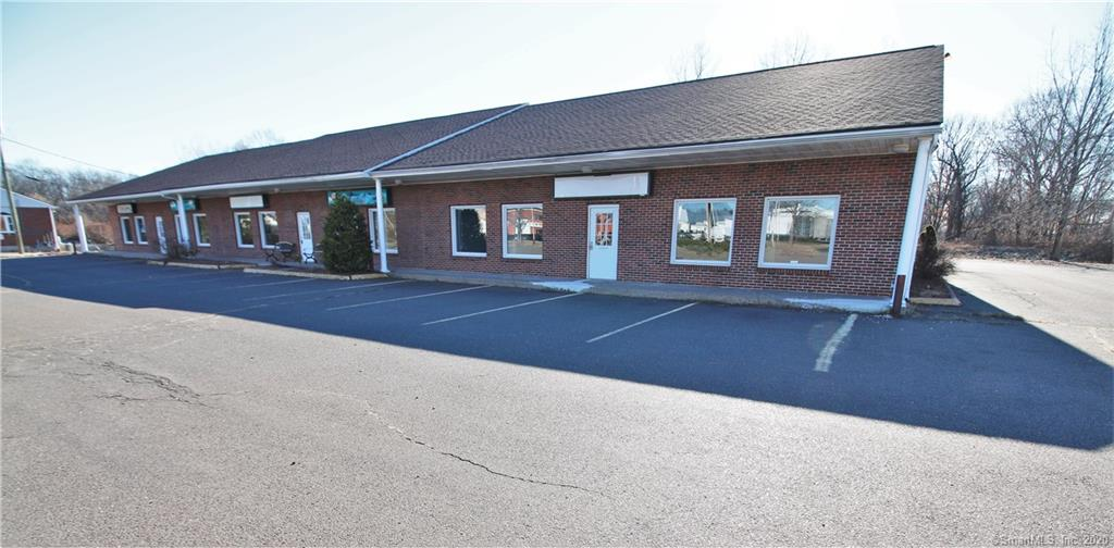 Nearly 7,000sqft freestanding brick front building.  Endless possibilities to owner occupy or for investment.  High visibility.  Zoned B-1.  All public utilities including natural gas.  Previous build out was for a large day car with 5 separate rooms, 4 bathrooms, laundry, kitchen, etc.  3 Separate front entry doors.