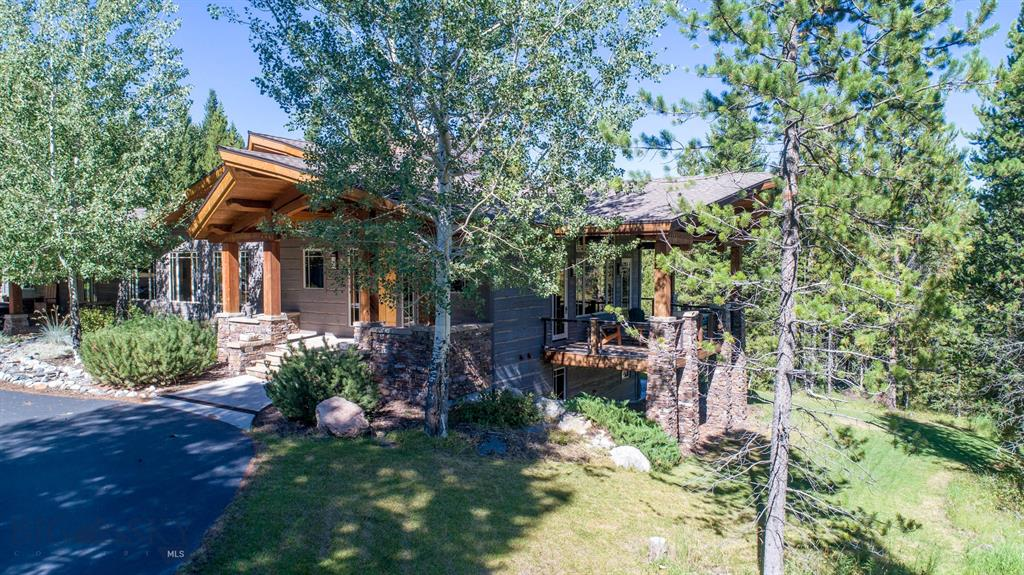 Stunning architecturally designed one-owner home sits on 4.54 acres located just minutes from Town Center in a private and quiet setting.  The home was designed for easy living and entertaining.  The spacious living room features a beautiful stacked stone floor-to-ceiling wood-burning fireplace with large windows and wrap-around decks, expanding the living space.  The open kitchen and dining area were made to accommodate friends and family with a great eat-in nook, large bar for seating and custom made round dining table situated next to its own fireplace. The main level also features a butlers pantry, large laundry room, powder bath, and master suite with private patio. The lower level walk-out features a junior suite with full bath, bunk room, 3/4 bath, family room with wet bar, and ample amounts of storage.  The detached 2-car garage is heated with additional shop space and features a private upper-level guest space with kitchenette, 3/4 bath, and custom sauna. Bring your horses!