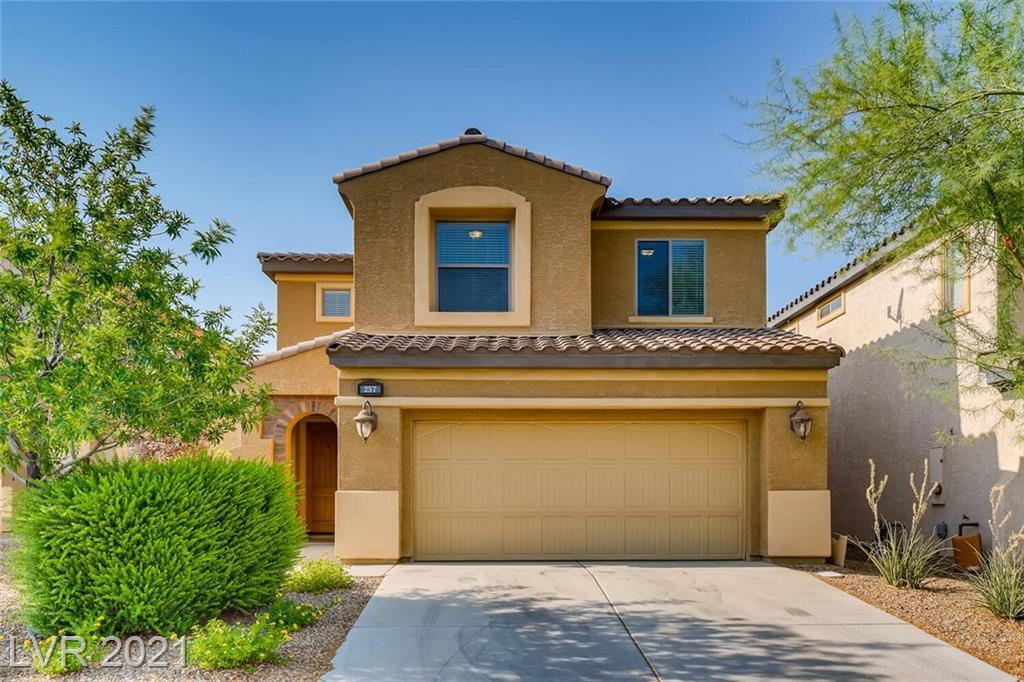 Beautiful home inside the guard gated Tuscany community! 2641 sq ft, 4 bedrooms, 2 1/2 baths, 2 car garage, plus a loft that can be a 2nd family room or office. No neighbors right behind so great for  privacy. Laundry room on the second floor, includes the washer and dryer (only 2 years old). Backyard with covered patio, pavers, and mature landscaping. Kitchen with granite countertops, and stainless steel appliances. Cozy up in the family room with a fireplace and a media center. Spacious master suite with separate shower and soaking tub. Plus a tankless water heater and water softener included.