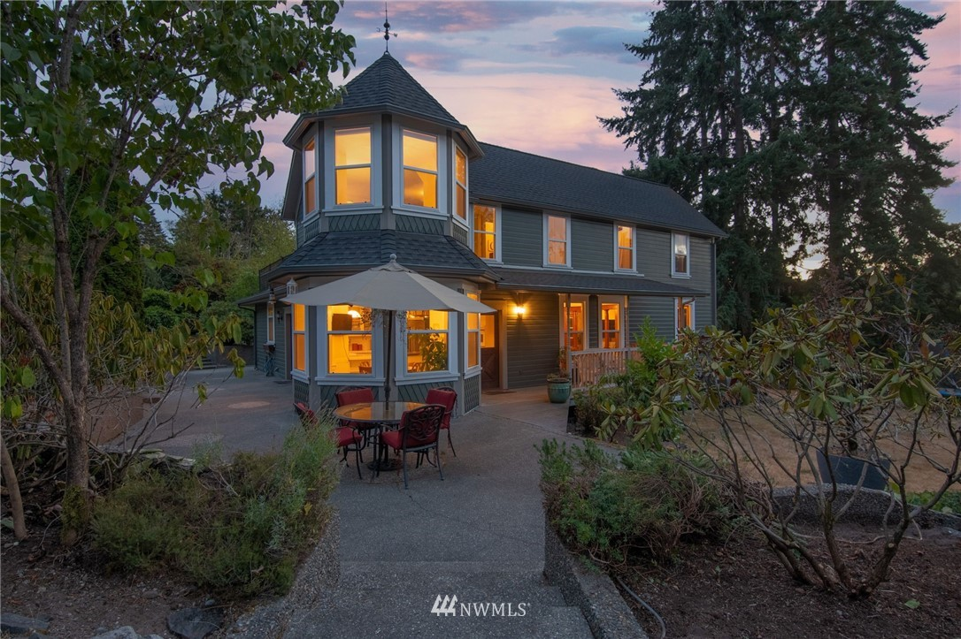 Beautiful, iconic home built in 1910. Walking distance to downtown Gig Harbor and the Marina. Nestled on a full acre of well established grounds with mature fruit trees, flora, and one of a kind firepit. Two story victorian style with turret makes this home unmistakable, along with its original hardwood floors, 5 panel doors, banisters, rich wood trim, pocket doors and ornate staircase. Private balconies off primary & guest bedroom. Spacious kitchen with cozy breakfast nook, separate dining area, multiple living spaces, RV hookup & across the street from Crescent Creek Park, making this home a true gem in the heart of Gig Harbor.