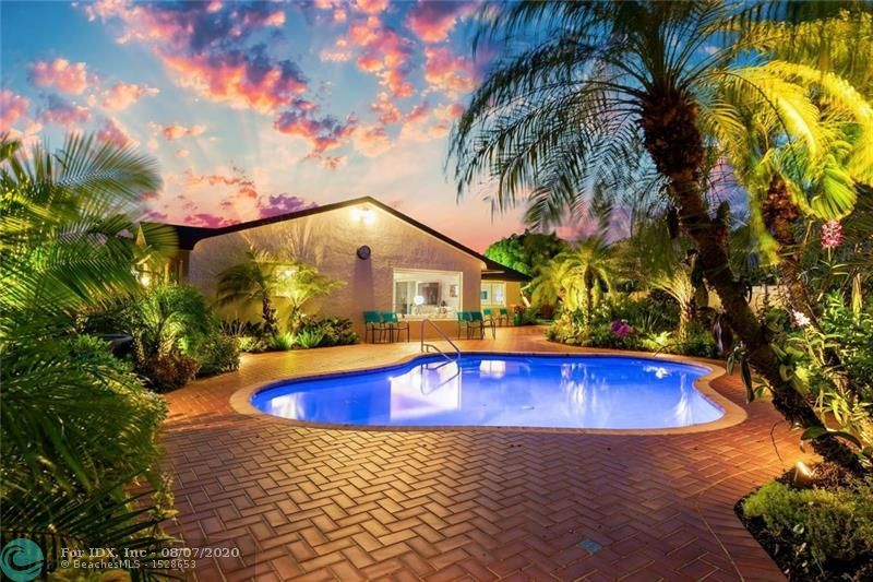 Breathtaking tropical oasis and only minutes from downtown Fort Lauderdale.  Spacious 3 bedroom 2 baths and large family room/kitchen combination looking out over the lushly landscaped and private lagoon pool (saltwater/heated) area.  Large two-car garage with glass front washer/dryer (included).  All new impact windows and doors, updated pool pump and irrigation system.  This home is tastefully furnished with all furnishings negotiable.  Royal Palm Lakes Estates (near both Royal Palm and Easterlin Parks)  is rapidly becoming popular with those who enjoy the convenience of the Wilton Manors nightlife, downtown Fort Lauderdale, minutes to the beach and the airport.  Owner occupied and shown by private appointment only.  Please contact listing agent for showings.