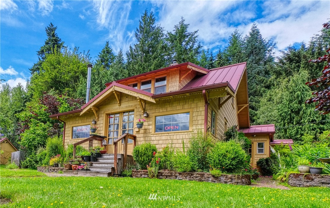 This beautiful home on the road to Mount Rainier is an Ashford landmark waiting for your vision. The main house has 2 bedrooms and 2 baths, the 2nd building has 3 additional 1 bed 1 bath units, each one cozier that the last. There is a fully finished 2 garage on 2.8 beautiful acres with massive growth opportunity including a barn, pasture area, gazebo with hot tub, picnic area and firepit all next door to Whittaker Basecamp. With the special zoning the possibilities are endless so see it today!