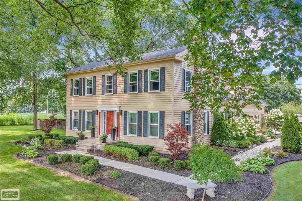 This STATELY Colonial has CURB APPEAL GALORE!  Situated on 3 peaceful, nicely landscaped acres.  Newer kitchen and flooring with wood burning stove off dining room.  Upstairs boasts a large living/bonus room area with 2 way fireplace, leading into HUGE adjoining bedroom! Many recent upgrades on attached Feature Sheet.  Outside has plenty of storage with a 50x30 dairy barn and 220x550 open air barn (3 sides enclosed).  Home Warranty included. Natural gas and paved road.  Award winning Armada Schools.  Immediate Occupancy. Location, location!