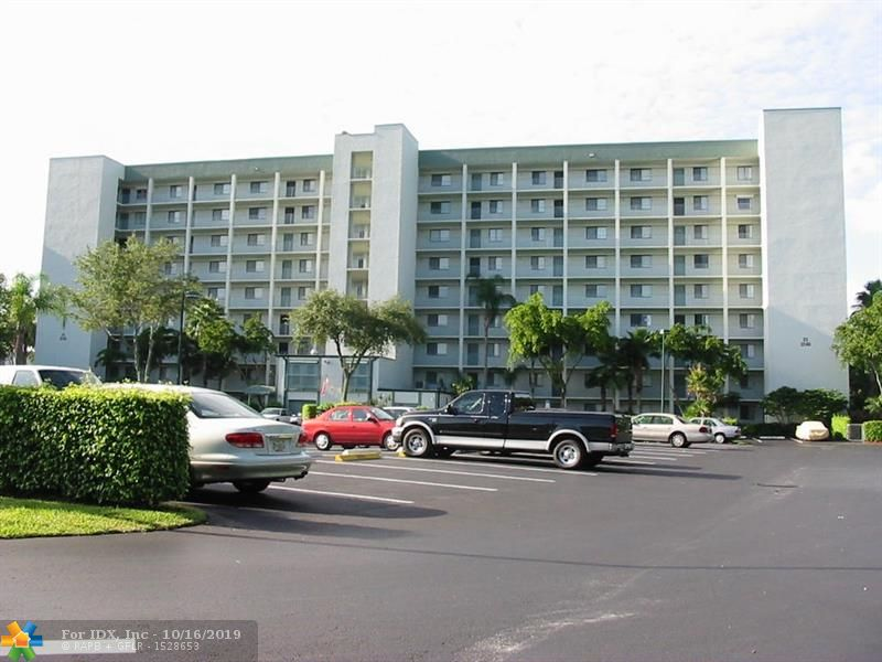 Very nice and partially updated 2/2 condo with a split floor-plan. This spacious condo which is only steps to the pool & clubhouse, has newer stainless steel kitchen appliances, a/c replaced in 2009, full-size washer/dryer inside the unit, electric hurricane shutters on the patio. The patio has a great lake view.  Can be sold partially furnished or unfurnished. Extra storage locker only a few steps from the condo.  The clubhouse has 2 billiards tables, social gathering area with kitchen + gym. This association has 2 large swimming pools + 2 hot tubs as well as 2 propane BBQ grills at each pool.  Motivated Seller & priced to sell. Sold AS-IS with a MAXIMUM 7 day right to inspect. 1 assigned parking space + plenty of guest parking. Car wash area provided.  Close to I95/Turnpike & Isle Casino