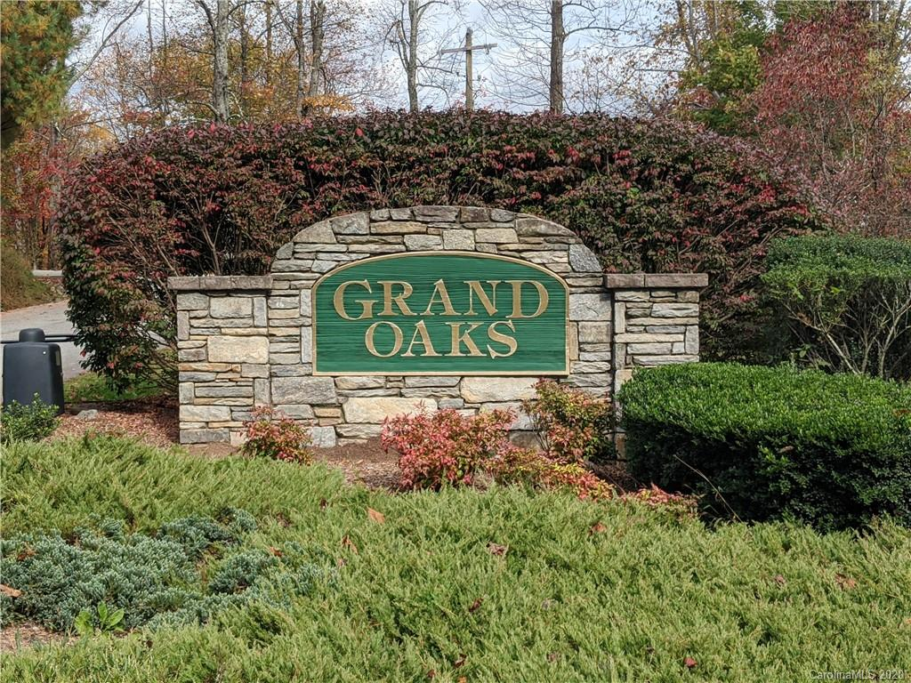Great price on a building lot in a gated community! Come see this lot that has been cleared inside Grand Oaks. Your short and easy drive up to the lot is not steep at all. Once there you have a partial long range view from the left hand side of the lot looking back towards the entrance. A two story residence may provide some views year round, buyer to verify. This wonderful community is only about 20 minutes to everything in Hendersonville. Come see it and make an offer to get started on building your dream home!