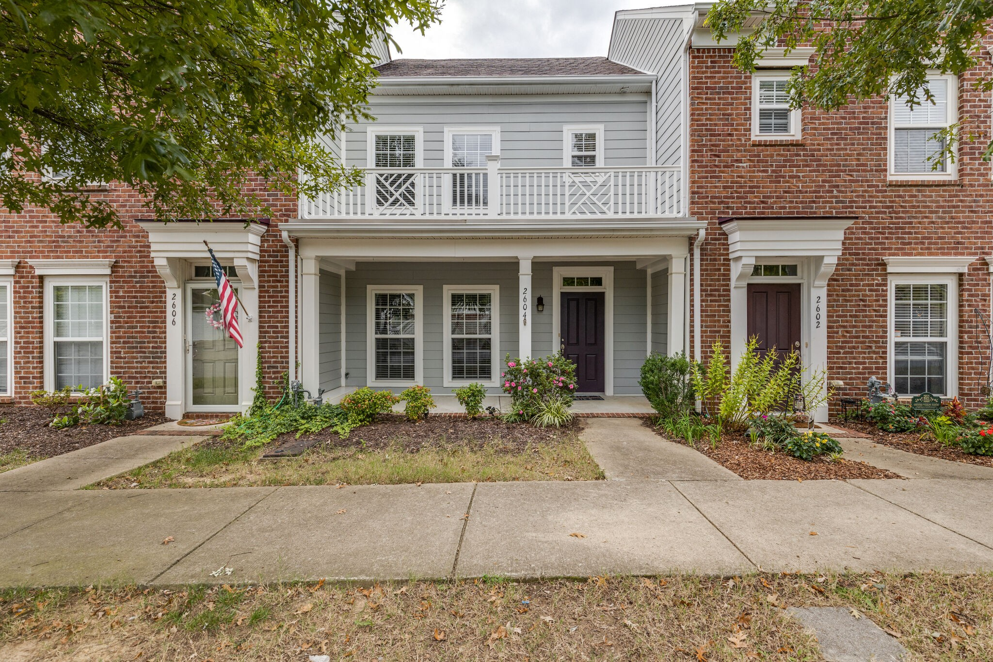 Move in ready townhome in Lenox Village.  Home features a large covered front porch, 3 Bedrooms, 2.5 Baths, all appliances remain, no carpet, upgraded lighting and more! Fenced backyard and driveway.