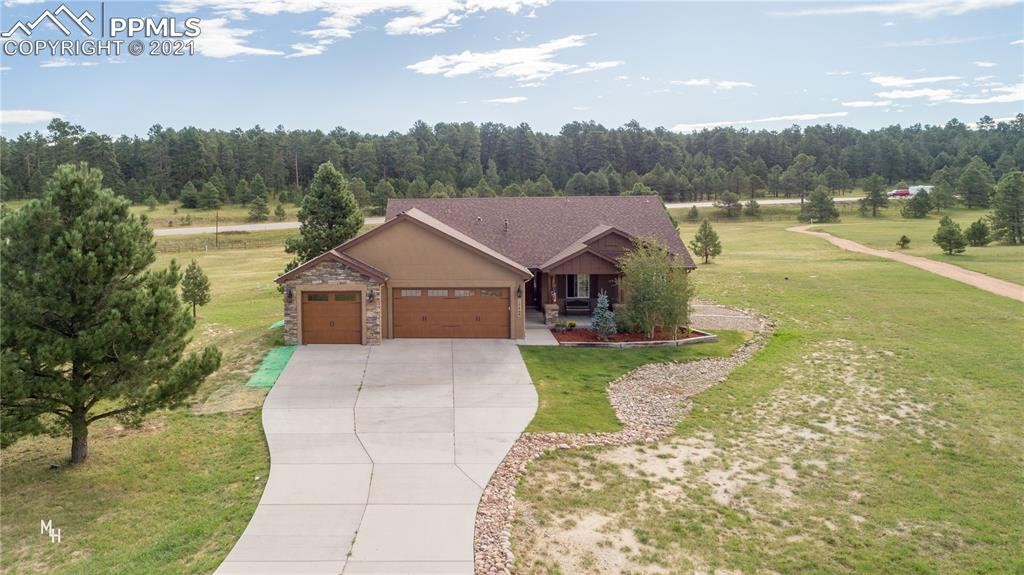 This custom Ranch Home sits amidst natural beauty with Majestic Mountain Views, & adjoins the subdivision Trail. Tucked into a cul-de-sac, yet minutes to Highway 83 for easy access to Colorado Springs, Monument, Castle Rock, & Denver. This creatively designed home has rustic elegance and embraces Colorado's natural beauty. The home offers an open concept, stone fireplace, built-in's, butler's pantry, natural lighting throughout, basement for entertaining or family time, great patio for outdoor enjoyment, and much more.