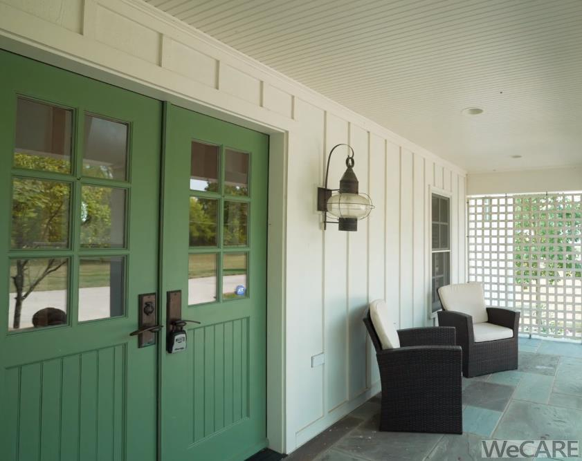 Double front doors, board and batten siding