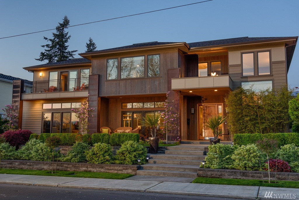 Stately NW Contemporary w/ a coveted West of Market address. Proudly situated on a gorgeous 115'x85' lot, this custom home exudes craftsmanship of the highest quality. Elements of cedar, copper & steel are paired w/ warm interiors, comforting spaces + luxe amenities. Above-grade footprint will impress the most discerning buyer. Views. Southwest orientation. Blocks to beaches/parks/downtown. Private backyrd w/ hardscape + lawn. Street-level front patios for the social butterflies. 4 car garage.