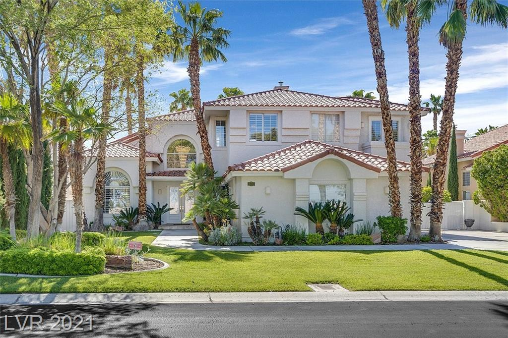 Elegant, beautiful model home in one of Las Vegas' finest golf course communities: Canyon Gate!  This house is perfect for entertaining - easy access to sparkling pool and spa from the family room.  Cool off under covered patio and enjoy easy outdoor cooking on built-in BBQ. Primary bedroom has sitting room, two walk in closets, and French doors leading to balcony overlooking private backyard.  Primary bathroom is well appointed with a steam shower, separate tub and two-way fireplace.  Your guests will enjoy a bedroom and private bath downstairs and two bedrooms upstairs. Kitchen has newer SS appliances, pantry and granite countertops. If you need storage, there are several closets and cabinets in the 3-car garage.  Centrally located close to Summerlin, Tivoli Village, Boca Park, this spacious home is a great find and a terrific value.