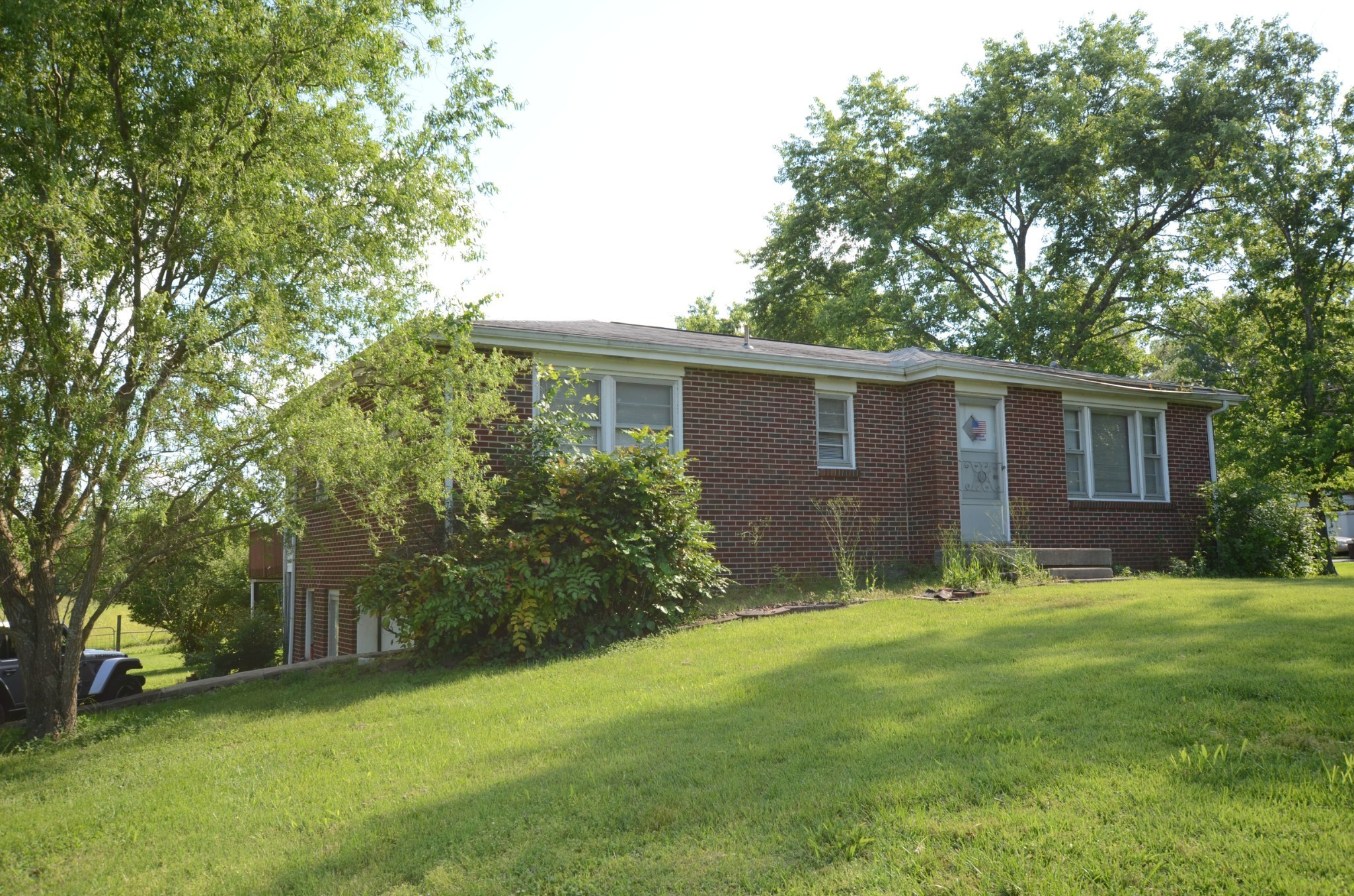 All brick ranch with full basement, ready for your renovation! Beautiful lot with plenty of trees and beautiful views! Large kitchen with plenty of cabinets. Large pantry area. Forrmal living room. Den with sunroom. Walk around deck plenty of room to entertain. 1 car garage and plenty of parking. Trane hvac