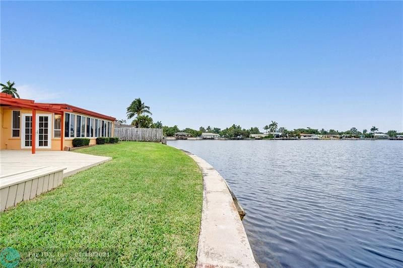 Undercover Gem!  Three bedroom/ two baths one story house. In the beautiful community of Coral Heights. Incredible view of the wide Lake from backyard and Florida room. Water view onf the East Coral Lake. No Ocean access.  Tile floors, walk-in closets, big driveway and open concept.   NO HOA, no gates or boats restrictions. Plenty room for a pool. Sales do not include Furniture. Your future home is close to many restaurants and shops in the area.  Close to Holy Cross Hospital.  2 miles from Beach and a few miles from downtown Fort Lauderdale.  Perfect home to make your own!