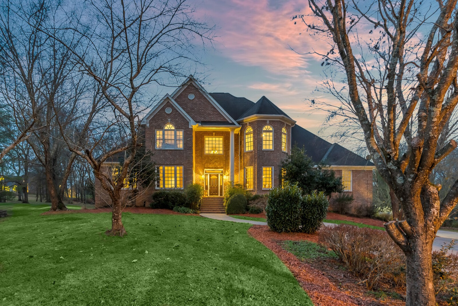 Beautiful executive home in prestigious Estates of BonBrook. Private 1 acre tree-lined lot on cul-de-sac, featuring over 7100 sq ft of living space on 3 levels. Main level opens to amazing deck w/ outdoor kitchen - overlooks resort style pool & fireplace. Master on main, 3 beds up w/ en suite baths. Walk out basement with separate entrance, bedroom & full bath. Updated polished concrete flooring & shiplap, sauna, living room & gym! Great as guest quarters/in-law suite or for entertaining!
