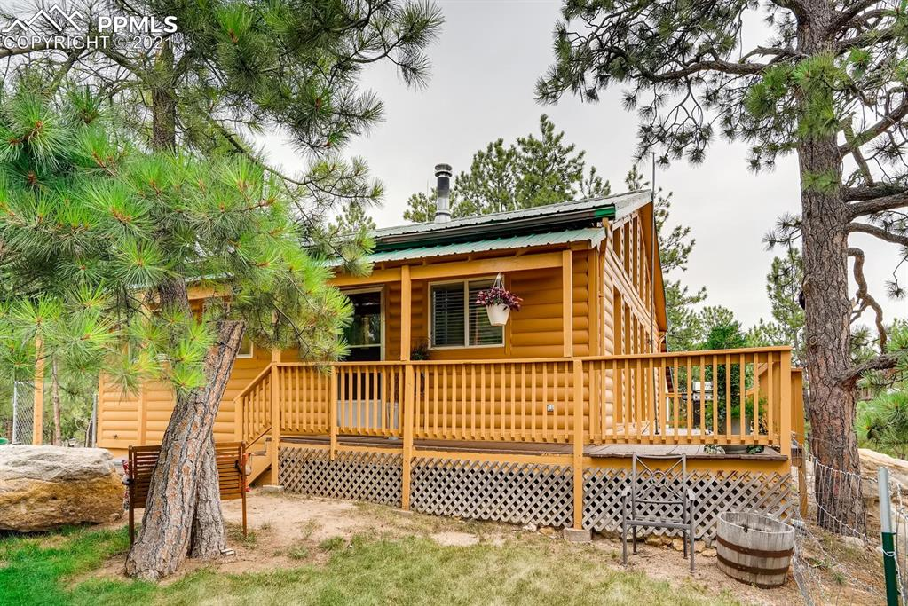 5 acres of trees, rock outcroppings, open floor plan and sun filled rooms plus a workshop, chicken coop and lots of storage, This is the one you've been waiting for! Come enjoy hiking and exploring on your own property with fresh air, beautiful views and peace and quiet. The wrap around deck & cozy fireplace are perfect for relaxing. The loft and large, organized, walk-in closets are also nice upgrades. Great access, great floor plan, great finishes, great property.