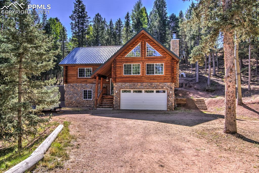 Beautiful Swedish Cope Log Home with river rock accented exterior.  Located on 1.26 wooded acres. This amazing home privately sits towards the end of a Cul-de-sac and offers peace and tranquility. As you enter the home you will be drawn in by the open floorplan, soaring 22-foot cathedral ceilings, huge wall of windows allowing tons of natural light in! You'll love the living room area with floor to ceiling, river rock fireplace.