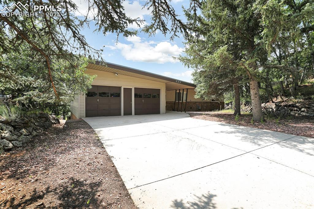 Gorgeous walk out ranch style home located in the desirable Skyway neighborhood.  Million dollar hillside and city views from the large deck of this amazing home.  Big open kitchen with custom cabinetry as well as large eating space which walks out to the deck.  Dedicated dining room which flows nicely into the huge main level living room compete with cozy fireplace.  Big master with 3/4 bath as well as two additional bedrooms on the main.  Fully finished walk-out basement with huge rec room with fireplace plus super cool built in bar!  Two bedrooms downstairs plus workshop and additional storage room.  Nice sized rear yard with more amazing views.  Storage shed Included!