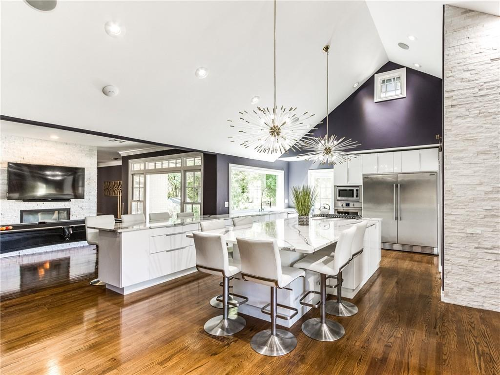 OPEN SUNDAY 2:00!!!! A Breathtaking Remodel! From the moment you walk in the front door you will feel at home! From the timeless wood floors to the quartz on the countertops this home is nothing but class. Truly a must see! The kitchen is a chef's or entertainers dream! Frididaire professional fridge, oven, microwave and 5 burner gas cooktop with a great pantry. Complete with three beds plus a study, 2 living areas, a see through fireplace looking through upon the dining room! The large master suite has a large walk in closet, an oversized tub, double vanities plus a make up vanity and an elegant shower.  The garage has an 8 ft overhead door with 10 ft ceilings and attic space above, it can store four compact cars. The driveway is a great size and can accommodate several vehicles. The roof and gutters were replaced approximately 6 months ago. This is a rare opportunity, call me today to schedule an appointment to see this home!