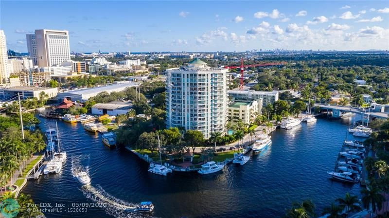 Back on the market with a big price reduction! Can be rented immediately, 2 pets up to 40lbs each, 2 garage parking spaces, tennis courts, sauna, gym, pool+ all in a well managed modern riverfront building. Located downtown on the Southside of the historic New River walkable to East Las Olas Boulevard, Broward Performing Arts Theatre & The Riverfront/Riverwalk area where you can find endless amazing restaurants, bars, parks, and cool city events like the Sunday Jazz Fest. Catch the water taxi just outside the building to travel the river and the Intracoastal Waterway. The unit has hurricane impact windows, bamboo floors, updated baths, separate laundry room, built-ins, large balcony with views of the river looking North and South & lots of night lights. Docking facility close by.