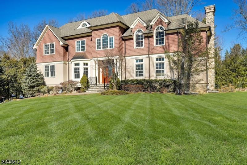 Proudly perched on a grassy knoll, this 2006 classic center hall beauty boasts a private and spacious backyard ideally situated in the desirable Hartshorn section on a quiet tree-lined street. Quality built by Geiss Custom Builders, this residence is impressive with high ceilings, custom millwork and thoughtful features throughout. The large, bright and open floor plan impresses with a two-story family room perfectly positioned next to a gourmet kitchen with custom cabinetry, stone counters and top-of-the-line appliances. A first floor in-law suite, four second floor en-suite bedrooms including an impressive primary suite with sitting room, generous custom walk-in closet and luxurious master bath, expansive third floor and lower level with rec room, bedroom and full bath offer plenty of space for all.