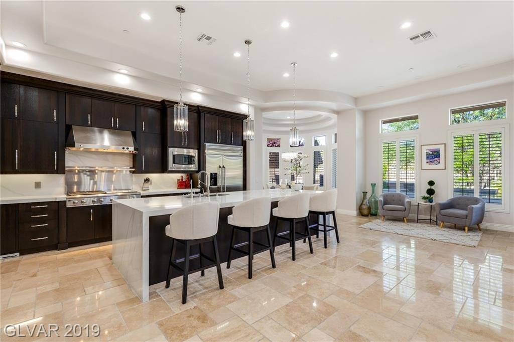 Remodeled for today's living, warm contemp home is sure to please. $200K spent! Intricate stonework, indoor-outdoor living,open floor plan w/high ceilings.Chef's kitchen, eating area, opens to familyrm, wet-bar,wine rm;theater rm. Lg office by entry.2 Masters.Bright & light hm, pristine! Strip views frM balcony.Amazing resort bckyrd w infinity pool/spa/firepit/BI BBQ, putting green.Backs to natural setting w serene views., ready for immd move-in!