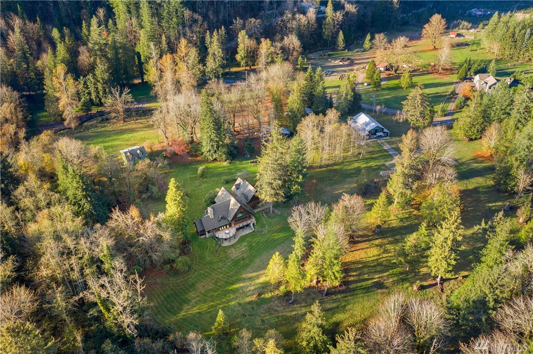 Recent Custom Build constructed beside the foothills of Mt Si & the Cascade Mountain range, consists of estate residence w/ separate living quarters, updated original 2 bed farmhouse, expansive workshop/studio, free range chicken yard & coop, 4 car garages, & storage sheds. Authentic Craftsman home was customized by showcasing locally sourced, quality materials & skilled artisans' handiwork to create a meaningful place of inspiration, entertainment & relaxation. Spectacular scenic views!