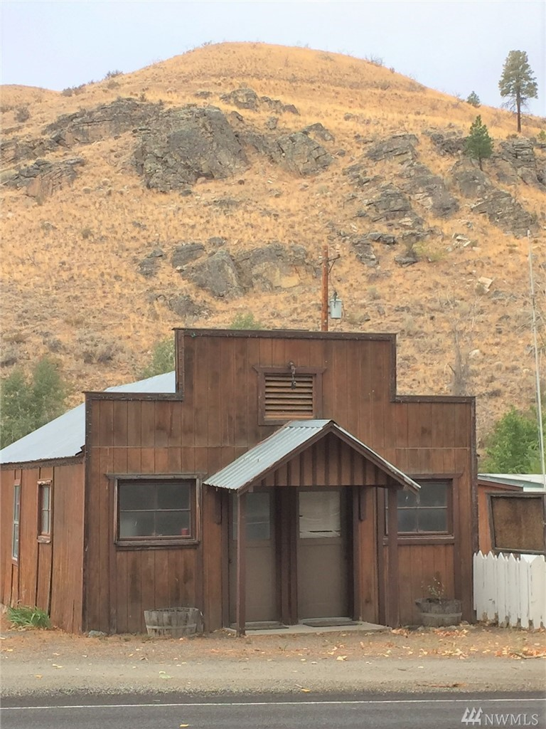 Old Methow post office on Hwy 153 has endless possibilities.  This fixer upper has two separate power meter bases and could be configured into an apartment and office space. Kitchen, bathroom, bedroom in one part and two rooms and half bath in the second half with separate entrances. Sold As Is.