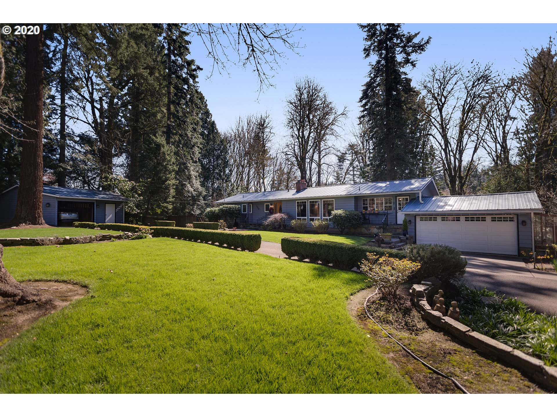 Lovely remodeled mid-century home on .97 acre in desirable West Linn neighborhood. Bright & airy with vaulted ceilings in living room & master suite. Updated eat-in kitchen with cherry cabinets, granite, high-end stainless appliances & cork floor. Living room has fireplace and cherry buffet & bookcases. Large, private entertaining deck backs to property's wooded ravine. Daylight basement has bonus room with fireplace, private guest room with private bath & huge woodshop. Blocks from the river.