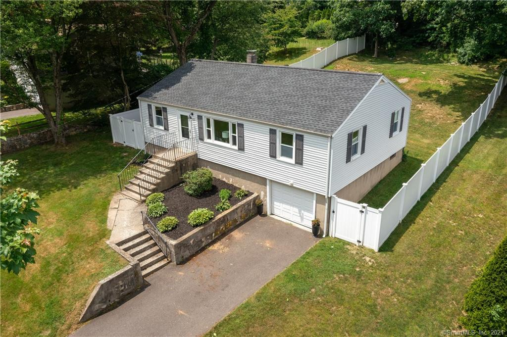 Perfect renovated home located on a coveted street in Fairfield Woods in walking distance to both Jennings and Fairfield Woods middle school.  Boasting nearly a half acre, this turnkey freshly remodeled home has everything you need from an open concept kitchen and living space with hardwood floors, to flex space that can be used as a home office, den or playroom, the options are endless.  The kitchen is renovated with with modern white cabinetry, quartz countertops and subway tile backsplash with room to add an island of your choice for an eat in kitchen area.  There are 3 generously sized bedrooms all with hardwood flooring and a large remodeled full bathroom that round out the first floor.  The basement is ready to be finished and add an additional 800 sq feet of living space.  The backyard is fully fenced adding privacy and security for you to enjoy the seasons.  NOTE, the seller has an updated survey showing the property lines extend well beyond fenced in area.