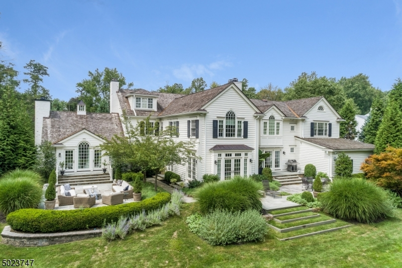 """Impeccable! Every inch of this 8041 sq ft Center Hall Colonial is perfection. Home was gutted, renovated & expanded with poured concrete foundation in 2010! All new electric, plumbing, heating, air conditioning systems, cedar shake roof, automated Vantage lighting system, generator & state of the art sound system. Ideal floor plan w/ a stunning  eat-in kitchen, family room w/ 9  ceiling & gas FP & 3 pairs of French doors to bluestone patio & stunning grounds, media room w/ 11  ceilings & gas FP, & 1st level in-law suite. Luxurious Master Suite with 10'5"""" ceilings & spa-like master bath w/ radiant heated floors, jacuzzi & steam shower. Ideally located on .97 acres of totally level property (plenty of room for a pool) w/ mature landscaping for privacy, on one of the most prestigious streets in Short Hills!"""