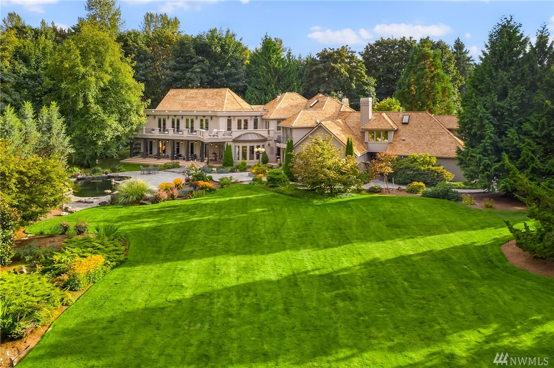 This stunning custom Broadhurst Estate will Exceed your most exacting Expectations! Built with the finest craftsmanship and highest quality finishes. A Soaring, Two-Story Great Room is Stunningly Grand, while Warm & Inviting. Beautiful Views of the Expansive Grounds, Gardens, Waterfall and  Koi Pond Can be Enjoyed from Wrap Around Terraces and Covered Patios. 24 French Doors Open to Seamless Indoor/Outdoor Living. Geothermal heating and cooling; 15 Minutes to Bellevue. Your private oasis awaits!