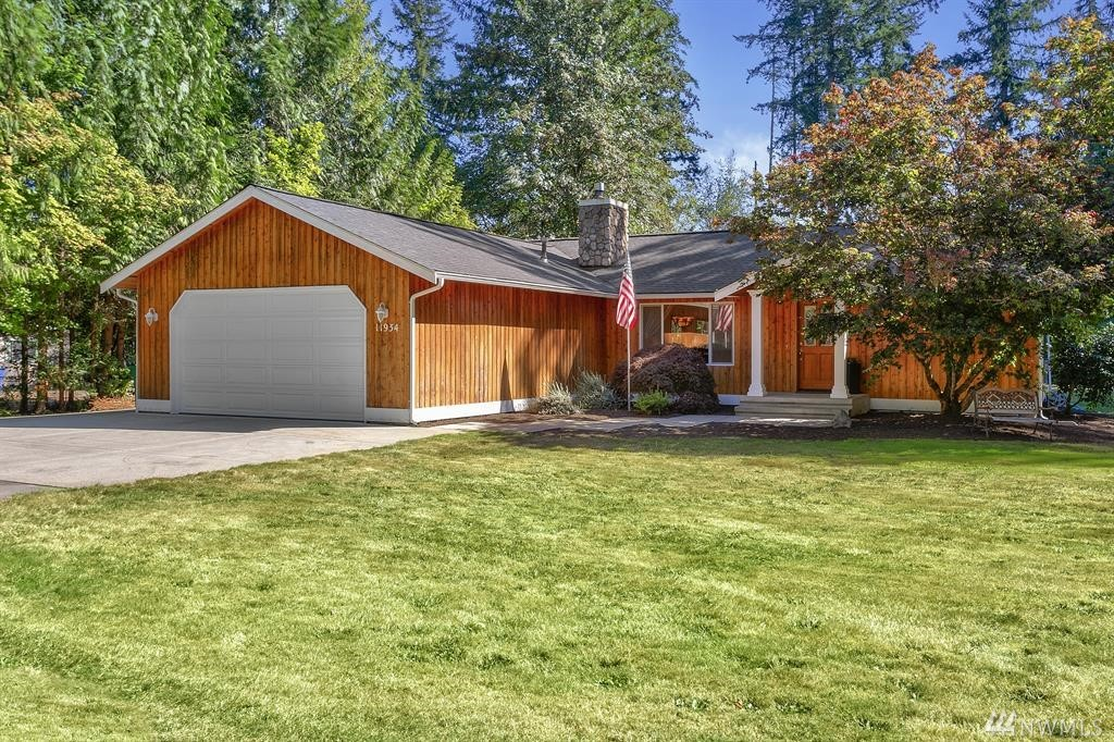 Sought-after one-story home on a full acre. Feel the warmth in this light, bright home featuring an open floor plan, vaulted ceilings, abundant windows & inviting hardwoods. Kitchen w/breakfast bar, hickory cabinets & granite counters. Enjoy both cozy gas fireplaces. Owner's suite w/private bath & walk in closet, step out to the deck & hot tub. 2 addt'l bedrooms & full bath. AC. Entertainment size patio, RV hook up & generator. Come relax & enjoy the wildlife. Just minutes from downtown Duvall.