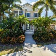 HOT OFF THE PRESS!! WAKE UP IN PARADISE! A GRAND WATERFRONT two story Keywest Style Home located on a RARE over sized CORNER LOT! BOOSTING over 11,000sq Ft  lot with  PANAROMIC VIEWS! NO BACKYARD NEIGHBORS! A DOCK, FULLY FENCED in BACK YARD! A lovely paved deck for your sunday parties and a screened patio for your comfortable sun rise coffee mornings!!! This home has all the upgrades as you will see scrolling thru the photos! Master bedroom located on the first level with water views, walk in closet and a high-end remodeled bathroom with Garden Tub! The family room living space features floor to ceiling  windows and three french doors to your WATER FRONT VIEW! The new carpeted second level boost three more bedrooms with a lofty walk way over looking your family room!!! OPEN LIGHT and BRIGHT!!! Don't miss seeing this property!!