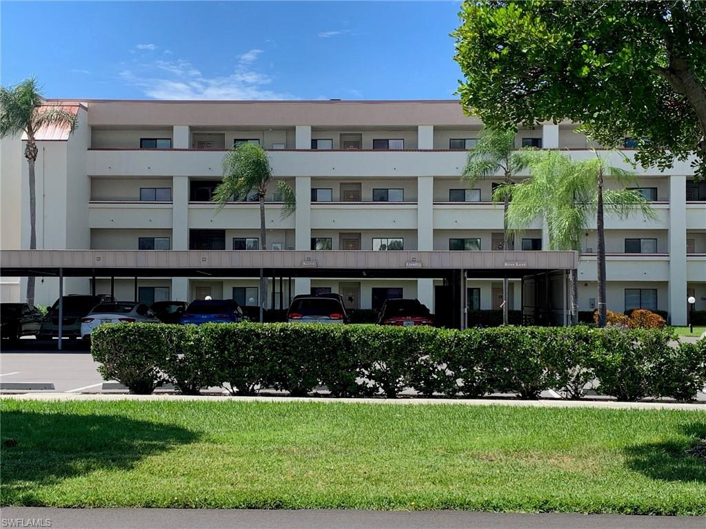 Meticulously UPDATED 2 Bedroom, 2 Bathroom Condo with Lake and Golf Course View! Includes Car Port and Golf Cart space. Granite Kitchen Counter Tops & Stainless Steel Appliances. Beautiful Wood Flooring. Plantation Shutters. Spacious Lanai with Tinted Windows and Hurricane Shutters. Newer Furnace/AC 2020. Hot Water Heater 2021. Low Electric Bills. Full Size Washer & Dryer. Tile Shower and Bathroom. Executive Golf Course that is Brand New! Golf Course assessment is paid in full! This Active Adult Community offers 6 Heated Pools, 6 Hur Tru Tennis Courts, Shuffleboard, Bocce ball, Pickle ball, Library Card rooms, Exercise room, Billiards, Wood Shop, Hobbies, Crafts, Cards, Restaurant, Full Time Recreational Area with Dinners, Movies and Dancing Events. Walking and Biking Paths. Pet Friendly. 24 hour manned guard gate. This community includes Golf, Tennis, Internet, Water, Sewer, Structure & Flood Insurance, Trash & Building Maintenance. Low Association fees per month includes golf with NO Transfer fees, no green fees and no food minimum. Centrally located for dining, shopping, RSW, Fort Myers & Sanibel beaches!