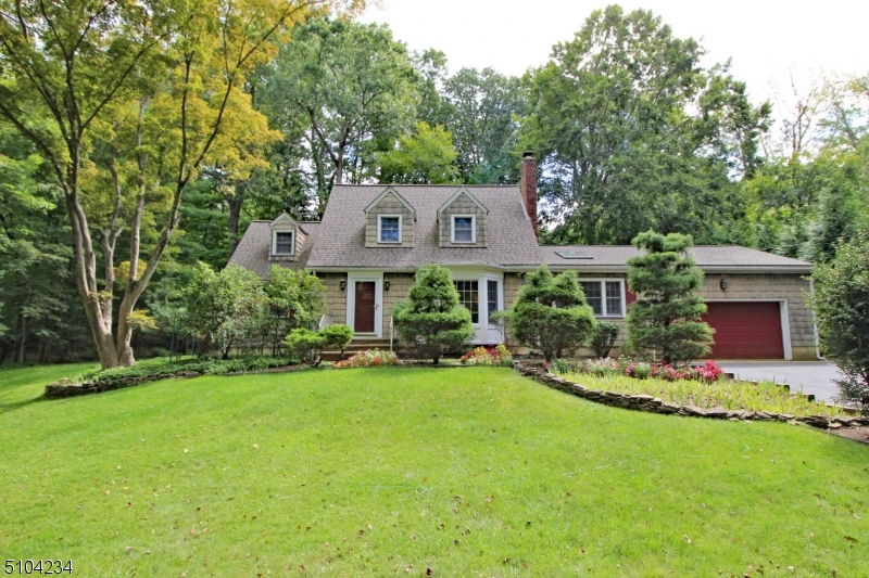 A rare find to own an income property in desirable Watchung Boro. Enter into the spacious living room with french doors that lead to the formal dining.Hardwoods and a wood burning fireplace complete the rooms.The large eat-in kitchen offers 2 ovens, a 6-burner Vulcan range, skylights and lots of counter space.There is also an oversized 2-car garage with a kitchen entrance. 2 bedrooms and a full bath complete this level. The second floor offers a living room, kitchen, bedroom, and full bath, with a walk-in closet.The basement adds additional space for storage and laundry.Serene yard with deck and paver patio. This house lends itself to mother/daughter and can easily be converted to a single family, with 3 bedrooms and 2 full baths.  Easy access to major highways, NJ Transit, and a highly rated school system.