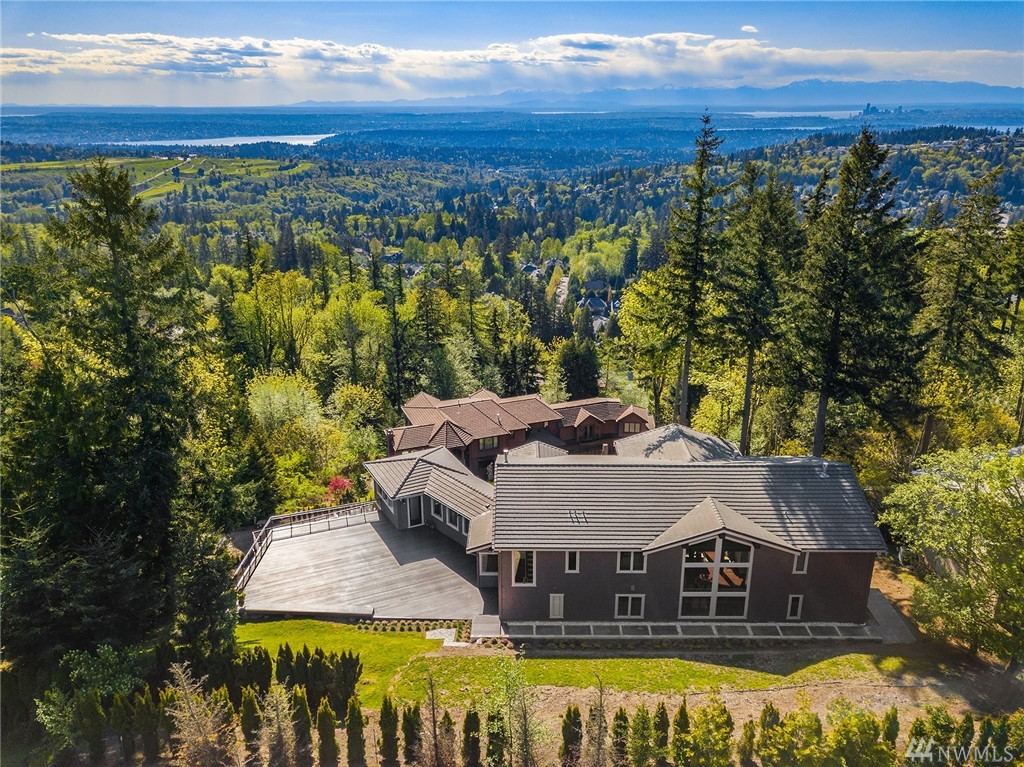 Stunning views, rustic architecture & modern amenities are just a few of the reasons to love this home. Custom-built & towering above it all at the top of The Pinnacle. 3-car attached garage, 22' ceilings in great room with wood beams & 4 decks. Smart home technology, eco-friendly flooring & views of the Olympics, Puget Sound, Lake WA, Downtown Bellevue and Seattle. 6 beds, 5 baths, gourmet kitchen, home office, theater, wine room, workout room, flex room and bonus space. Truly breathtaking!