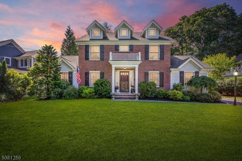 Nestled in the heart of Wychwood, this 4 bedroom 3.2 bathroom turn key colonial awaits you! Updated to perfection, you will be wowed by the gracious foyer flanked by formal LR & DR. Newly updated kitchen w/center island, 2 sinks (Shaw),& stainless appliances (Viking) opens to a beautiful breakfast room. Expansive Family Room with high ceilings, wet bar & gas FP. Primary suite w/ dressing room/walk-in closet, and bath (dual sink & stall shower). 3 add'l beds (2 w/ ensuite baths) complete the 2nd FL. Lower level w/ office, Rec Room, Fitness Room, Powder Room and Laundry round out the interior of this impeccable home. Exterior features incl. a professionally landscaped, fully fenced rear yard w/ large patio and wood burning FP.  Too many features to list (See detailed Highlight Sheet for more!). A MUST SEE!
