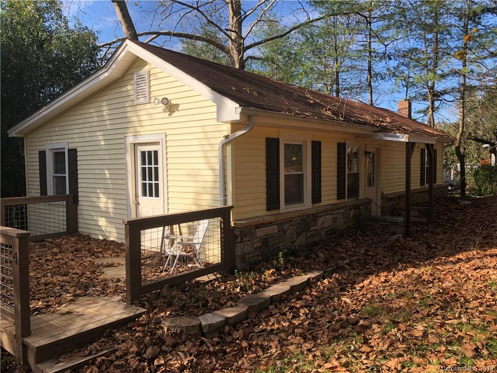 Totally remodeled. New heat and air. New flooring. New tile. New kitchen cabinets. New porch railings. New doors. New carpet. New paint. New county approved septic. New! New! New!  Walk to store or local bar. Convenient to Asheville on 5 lane Scenic Hwy 74A or Cane Creek Road to airport mega shopping and I-26. 999=Tax Value TBD. Corner commercial building also available for total of .526 acres / $270,000. See MLS# 3567877