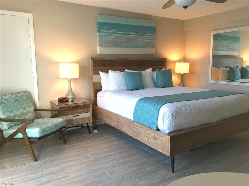 """This beautiful CONDO/HOTEL located in the Historic Cove Inn with its coastal colors, tile floor, kitchenette with refrigerator, coffee maker, and microwave. King bed, night stands and lamps and dresser. Table and two chairs. Bathroom with all new tiled shower. This room has everything new as it was redone after Hurricane Irma making it ready for rentals. Sit on your balcony and look over the bay. There's a Chickee Hut for your afternoon drinks and a pool for owners/ tenants enjoyment. Main lobby is pleasant to meet your friends and the """"famous COVE INN RESTURANT"""" with its excellent food. Walk to Fifth Avenue for shopping and dinner and don't forget Third Street South for more shopping and fine dining. Close to Crayon Cove and Tin City and the City Dock. So much to enjoy in Naples. This one won't last long. This room has a premium rating for the hotel if you wish to put it in the rental pool or just keep it for yourself to enjoy and relax. The hotel has beach chairs and bikes for your added pleasure."""