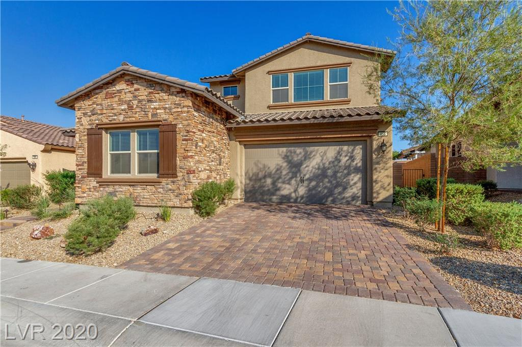 An Absolute Diamond in the Desert.  This is your rare opportunity to acquire a magnificent two-story home with a million dollar Las Vegas Strip view, too many upgrades to keep up with, all behind the guarded gates of Heritage at Cadence in the City of Henderson, Nevada.  Built in 2016 and with only one previous owner who used it as a vacation home, 656 Rose Apple has the look and feel of brand new, without the brand new price.  Marvel in the dynamic use of space both downstairs in up, with a large kitchen, dining area, and family room gracing the entry, attached to both the master bedroom, laundry room, and large pantry.  A second downstairs bedroom adorns the front of the house near the entry, giving space to those who require privacy.  The upstairs is a bastion of escape, where one is met by a large kitchenette area with sink and microwave.  As you continue, be amazed by nighttime Strip views rivaled by only the most elite neighborhoods in the Valley.  A must see for 55+ living.