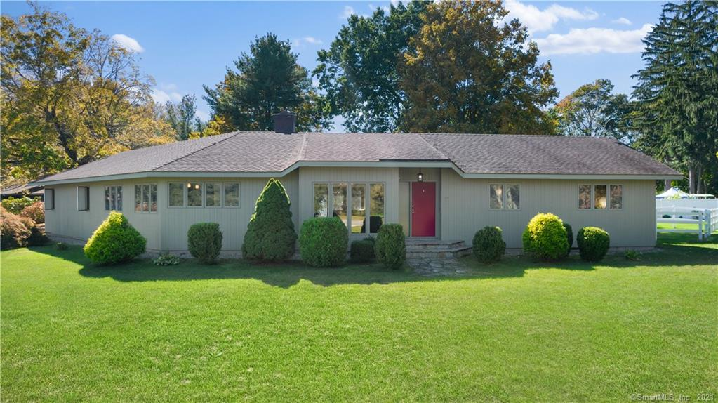 Welcome Home to this Stunning Mid-Century Modern Ranch Located Just Minutes from I384.  Serenely Set Directly Across from Manchester Country Club Golf Course and Globe Hollow Reservoir...Gives a Glorious Display of the 4 Seasons at your Front Door!  Open Floor Plan with Fabulous Great Room Featuring Vaulted Teak Ceiling and Floor to Ceiling Stone Fireplace, a Wall of Windows with Sliders lead to a Deck and Paver Patio with a Hot Tub For Relaxing! Formal Dining Area  Takes in the View of the Golf Course and Reservoir Beyond.  Large Kitchen Fully equipped with Subzero Refrigerator, Range, Microwave, Dishwasher, and Dining area with a Wall of Windows Taking in The View!  With Three Bedrooms 2 1/2 Baths All On One Level, This Home Could be Easily Handicapped Modified. Primary Bedroom has New Bathroom Featuring a Steam Shower and Bubble Tub. Oversized Heated insulated 2+ Bay Garage for the Auto Enthusiast.  Expansion poss. in 2200 sq.ft. Basement with Rough Plumbing for 3 Baths & Fpl. Flue. City Water and City Sewer. See Virtual Tour!