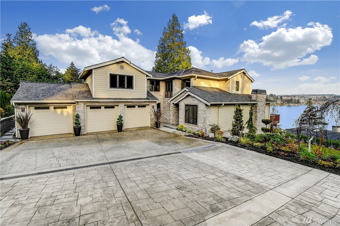 Spectacular newly constructed view home on the north end of Mercer Island! Easy access to I-90 just minutes to Seattle or Bellevue. Perched above Lake Washington, wonderful lake views from each floor. Built with extraordinary detail and craftsmanship, this home features a diversity of materials and technology. Five en suite bedrooms. Self sufficient lower level with kitchen and utility room. Created for entertaining, gatherings and relaxation, this property is a true sanctuary.