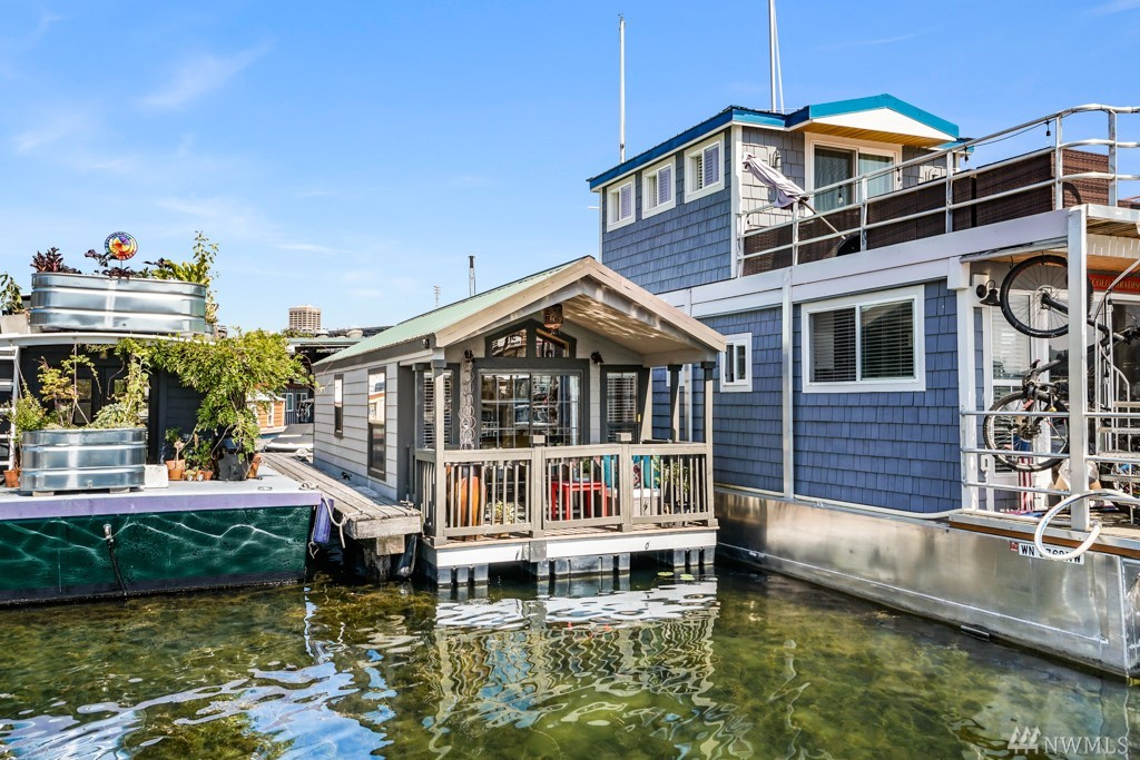 """Live on the lake! WELL MAINTAINED """"Charlotte"""" houseboat. Enjoy the summers on the covered patio entertaining guests. High ceilings & open concept bringing in natural light w/ view of water. Easy to maintain and manage w/ restaurants & shops within walking distance making this the perfect getaway w/ little effort! Potential Bonus to build up for rooftop deck! Affordable slip rent per month + $200 live-aboard fee, includes water + garbage. Parking slip and off-street parking. No pets allowed."""